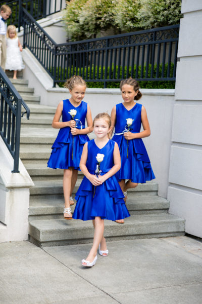 Flower girls in royal blue dresses are carrying singe white roses, Summer Wedding