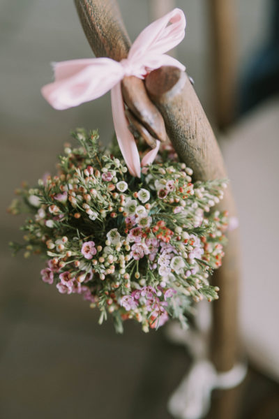 Waxflower pomander in pink and white hanging on a chair with a pink ribbon, Wedding Flower Choices-April, pink, peach tulips, peony, wedding blog