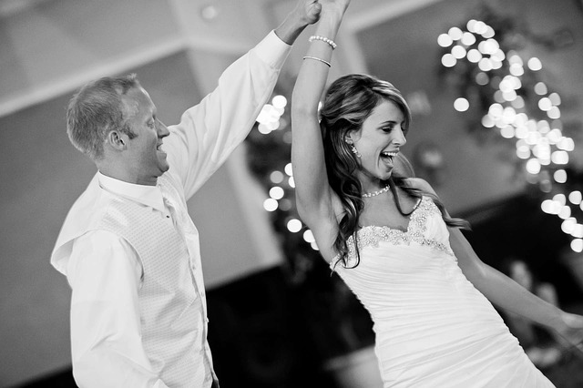 staying calm on your wedding day, Bride and Groom having fun and dancing in black and white