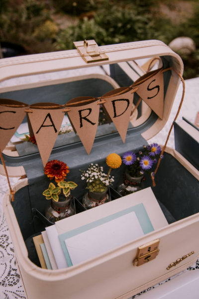 cream colored suitcase to hold wedding giftcards