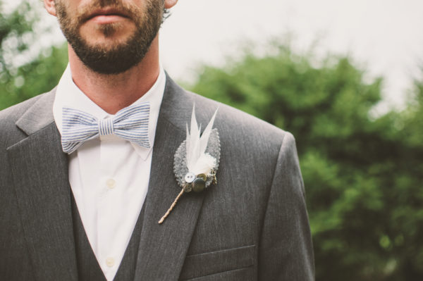 Groom in gray suit with boutonniere